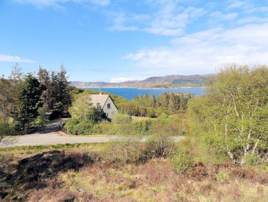 The house with Gairloch in the background